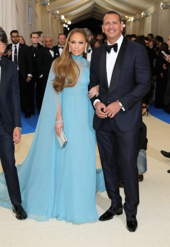 Jennifer Lopez in Valentino with a Judith Leiber Couture bag and Alex Rodriguez
